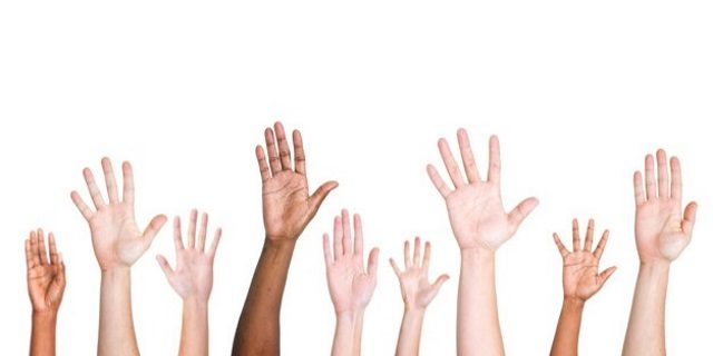 diverse-group-raised-hands_53876-22986